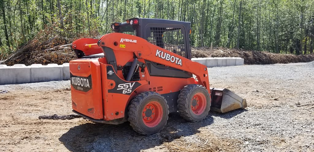 Rear angled view of Kubota skid steer on a property in British Columbia
