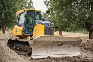 A crawler carrier shovelling dirt