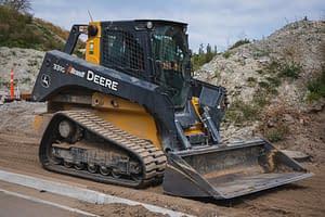 John Deere CTL clearing a path