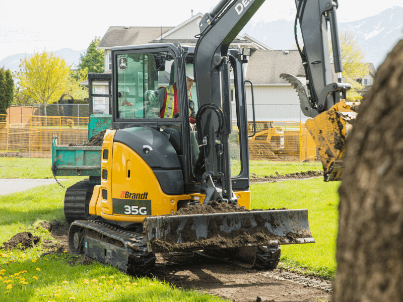 John Deere mini excavator landscaping a yard digging